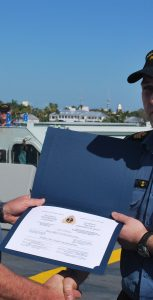 PO2 Eric Caron receives his Machinery Watchkeeping Certificate from Cdr Yves Tremblay, his Commanding Officer on board HMCS Fredericton. Photo credit: Submitted
