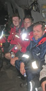 Safely aboard a 413 (Transport and Rescue) Squadron Cormorant early May 27, the crew of the lost schooner Sorca with SAR-Tech MCpl Ryan Morris. Photo: submitted