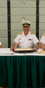 From left, RAdm Craig Baines, RAdm John Newton, and Cmdre Craig Skjerpen sign the official documents at the Change of Command ceremony for Canadian Fleet Atlantic on July 18. Photo: Cpl J.W.S. Houck, FIS Halifax