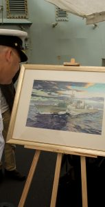 Rear-Admiral Craig Baines is presented a painting adaption of a photo by Corporal Anthony Chand during the Canadian Fleet Atlantic Change of Command ceremony on July 18.  Photo: Cpl J.W.S. Houck - Formation Imaging