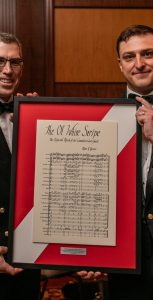 CCG Commissioner Jeffrey Hutchinson, left, and PO2 Matt Reiner of the Stadacona Band, show off the framed sheet music for The Ol' White Stripe, the new Official Coast Guard March. Photo: Melanie Rebane Photography