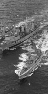 HMCS Preserver performs a replenishment at sea in 1971. Photo: DND