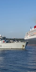 Cunard Line Queen Mary 2 performs a sail past in Halifax Harbour in celebration of Canada 150 escorted byHer Majesty's Canadian Ship (HMCS) Summerside on August 10, 2017. As Queen Mary 2 sails past, the Atlantic Cadets, HMCS Acadia Cadets provide a 21 gun salute while the Naval Reserve National Band plays O'Canada. Photo Credit: Mona Ghiz, MARLANT PA HS88-2017-0181-419