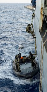 Members of the Royal Danish Navy's Boarding Party disembark from HMCS Charlottetown and board a rigid-hulled inflatable boat during Operation REASSURANCE on October 3, 2017, while on Exercise BRILLIANT MARINER. Photo: Cpl J.W.S Houck, FIS