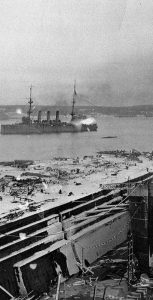 Photograph of Halifax looking south after the blast, showing ships in the Harbour and destruction on the shore. Photo: Library and Archives Canada