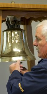"""Bryan Hughes rings the bell signifying """"roll call"""" honouring deceased members of the ship's company of HMCS Kootenay. LS Trent Galbraith, FIS"""