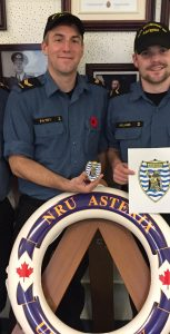 LS Douglas Williams, LS Brandon Patey and AB Patrick Williams display their original artwork and the first produced Unit Patch for NRU ASTERIX. Photo: submitted