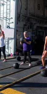 Members of HMCS Montréal participate in a fitness class on the flight deck during the NEPTUNE TRIDENT 17-02 deployment. LS Dan Bard, FIS Halifax