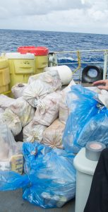 Crewmembers move seized narcotics off HMCS Moncton as part of the drug bundles transferring process to the US Coast Guard on November 11 during Operation CARIBBE.  Photo: 12 Wing Imaging