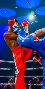 PSP Fitness and Sports Instructor Thomas Dalziel, right, got his first pro kickboxing victory on December 18 in a main-event match American fighter Ravon Baxter of Nashville during the World Combat Arena fight card at the Montreal Casino. Photo: Courtesy of Manseau Sports Photos