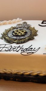 Heather Scott, a cook supervisor in the galley at Juno Tower, created and decorated the birthday cake to mark the 50th anniversary of the Logistics Branch. Photo: RYAN MELANSON, TRIDENT STAFF