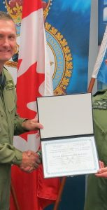 2Lt Kyle Rebryna receives a 2 Canadian Air Division (2 CAD) Commander's Commendation from Brigadier-General Dave Cochrane, commander of 2 CAD, for his outstanding contributions to the Division while he was awaiting his next phase of occupational training. Photo: SUBMITTED