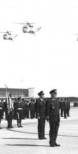 Undated photo shows Sea Kings flying past as airmen stand on parade. Photo: SHEARWATER AVIATION MUSEUM