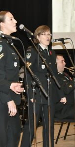 36 Canadian Brigade Group (NS) Band vocal trio Cpl Mark, Cpl Cuming and MCpl Mayka sing Don't Sit Under the Apple Tree and Boogie Woogie Bugle Boy during MARLANT'S 17th annual 'Til We Meet Again concert at the Halifax Central Library on November 10. MARGARET CONWAY, A/BPAO