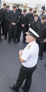 RAdm Craig Baines speaks to a group of sailors. SUBMITTED