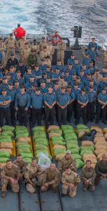 HMCS REGINA's crew poses with over 2000 kilograms of narcotics seized from a dhow during Operation ARTEMIS in the Pacific Ocean on April 7 2019.  Photo: Corporal Stuart Evans, BORDEN Imaging Services ©2019 DND-MDN CANADA XA01-2019-0179-001