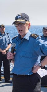 Standing NATO Maritime Group 2 Commander, Commodore Josée Kurtz addresses the crew of Flag Ship Her Majesty's Canadian Ship TORONTO on the flight deck while in the Mediterranean Sea on June 21, 2019 during Operation REASSURANCE, ROTO 10.   Photo:  MCpl Manuela Berger, Formation Imaging Services Halifax RP23-2019-0238-001