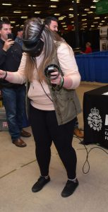 Sgt Tim Keith from CFRC assists a student as she experiences the CAF through virtual reality. This was one of many skilled trades and technology activities available at the 2019 Skills Canada National Competition, held May 28 and 29 at the Halifax Exhibition Centre.  SGT DIANNE LAMBERT, CFRC ATLANTIC