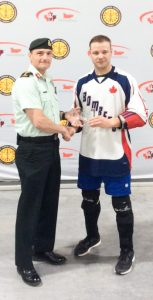 Team Atlantic MVP MCpl Pierre Poulin receives his award from MGen Sylvain Sirois after the finals of the CAF National Ball Hockey Championship on July 26. SUBMITTED