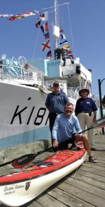 A job well done: Kayaker Steve Chard (foreground), from Dorset, England, with HMCS Sackville crew members, OS Ryan Hurry (left), and LS Chad Fulford (right), and Canadian Naval Memorial Trust chairman, Cdr (ret'd) Wendall Brown. SUBMITTED