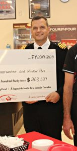 From left, SISIP Financial Branch Manager Jim Boylan presents the Base Fund cheque to Cdr Ian Bye, along with CANEX CFB Halifax and 12 Wing Manager Glenn Banfield. RYAN MELANSON, TRIDENT STAFF
