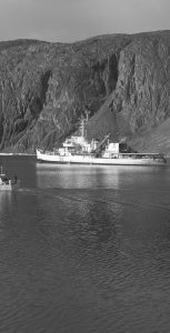 The first deep draft transit of Bellot Strait: POGO leads HMCS LABRADOR past Magpie Rock, August 24, 1957. DND