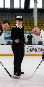 OS Kimberly O'Dell, acting as Commander for the day ahead of the Hands' Dinner, dropped the puck to kick off the inter-ship game on December 13. OS SAIF MORSY, HMCS MONTREAL