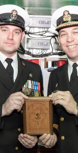 MS James Millbury, left, receives his Sailor of the Year plaque from Cmdre Richard Feltham, Commander CANFLTLANT. MS Milbury was named the fleet's Sailor of the Year during a ceremony held aboard HMCS Summerside on March 11. MONA GHIZ, MARLANT PA