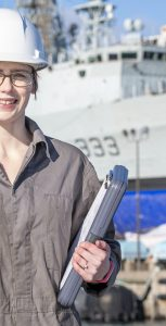 Ashley Campbell, Control System Engineer, Fleet Maintenance Facility Cape Scott, DND on 2 March 2020 with Her Majesty's Canadian Ship Toronto at FDUA jetty in background. Photo Credit: Mona Ghiz, MARLANT Public Affairs HS88-2020-0033-133 © 2020 DND-MDN Canada