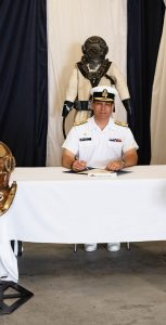 From left, outgoing CO LCdr Patrick Fournier, Cmdre Richard Feltham, and incoming CO LCdr Neville Lockyer sign the Change of Command certificates during a ceremony at FDU(A) on June 30. 12 WING IMAGING