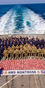 CAPTION 1 The crew of the HMS Montrose on their flight deck with their 2.7 tonne capture on February 6. CTF 150