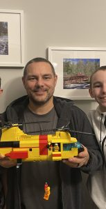 Master Warrant Officer (retired) Dan Pasieka, centre, holds the LEGO model built by his sons, Mike and Denis, of the CH-113 Labrador he flew in for years as a Royal Canadian Air Force search and rescue technician. SUBMITTED