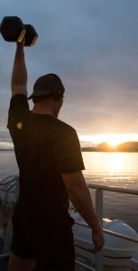 A member of HMCS WHITEHORSE does some weight training while sailing in preparation to respond to Operation LASER or Operation LENTUS tasks on April 23, 2020. S1 SISI XU